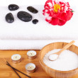 Spa setting with candles, flower, towel and stones — 图库照片