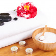 Spa setting with candles, camellia flower, towel, salt and stone — Stock Photo