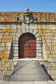 Old castle door and drawbridge — Stock Photo