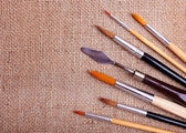 Brushes on canvas — Stock Photo