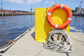 Bright red lifebuoy on the deck — Stock Photo