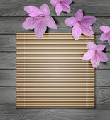 Tropical flowers and bamboo on a wooden background — Vettoriale Stock