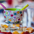 Empty chocolate fondue cup - Stock Photo