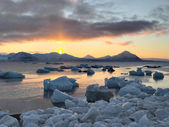 Sun rising above freezing Arctic fjord - Spitsbergen — Stock Photo