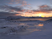 Sunset over the Arctic fjord - Spitsbergen — Stock Photo