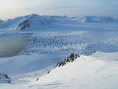 Arctic glacier - view from the mountains — Stock Photo