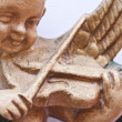 Stock Photo: Figure of angel playing the violin.
