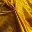 Stock Photo: Yellow fabric wrap on buddhimage