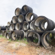 Stock Photo: Stack of old concrete drain pipes