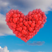 Red balloons forming a heart on sky — Stock Photo