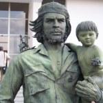 Постер, плакат: Guevara statue with a child