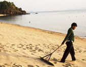 Sweeping the beach — Stock Photo