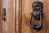 Κnockers on old door — Stok fotoğraf