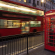 Bus and telephone box, London - Stock Photo