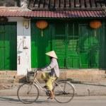 Постер, плакат: Riding a bicycle in Hoi An Vietnam