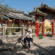 Riding a bicycle in Hoi An, Vietnam - Stock Photo
