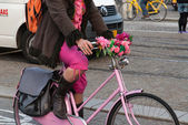 Riding a bicycle in Amsterdam — Stock Photo