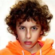 A portrait of a young handsome Caucasian boy with curly hair — Stock Photo