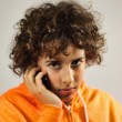 A young boy is speaking on the mobile phone — Stock Photo