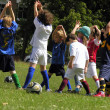 Little kids on football training in the park - Stock Photo
