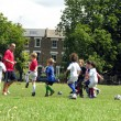 Kids playing football in the park — Stock Photo #23972391