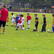 Kids playing football in the park — Stock Photo #23972409