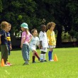 Kids playing football in the park — Stock Photo #23972411