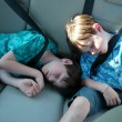 Tired young boys are sleeping in the car — Stock Photo
