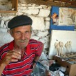 Постер, плакат: Local old craftsman drinking tea