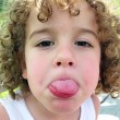 Little boy sticking his tongue out — Stock Photo #23973449