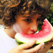 Boy is eating watermelon slice — Stock Photo