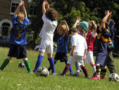 Little kids on football training in the park — Stock Photo