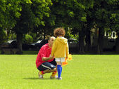 Football coach is talking to a little player — Stock Photo