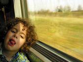 Little boy bored on the train journey — Stock Photo