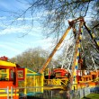 Traveling funfair in a local park - Stok fotoğraf