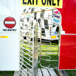 Stock Photo: Exit only turnstile of funfair