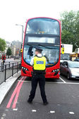 London bus and police — Stock Photo