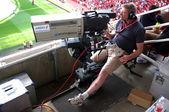 Cameraman at work during a live soccer game — ストック写真