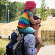 Child is on Father's shoulder — Stock Photo #29551983