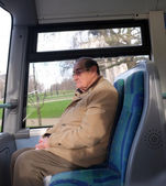 Elderly man on the bus — Stock Photo