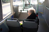 Elderly woman on the bus — Stock Photo