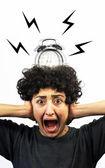 Alarm rings on woman's head — Stock fotografie