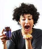Woman holds pills in her palm — Stock Photo