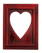 Love symbol hole on a red frame — Stock Photo