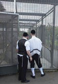 Two Jewish men look at the bird cage — Stock Photo