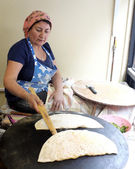 Turkish woman cooking pastry — Stock Photo