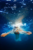 Professional female sport master smiling underwater — Stock Photo