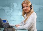 Attractive young blonde girl as online support service — Stock Photo