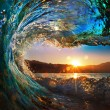 Sunset on the beach with screw ocean wave — Stok fotoğraf