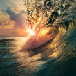 Sunset on the beach with screw ocean wave — Stock Photo